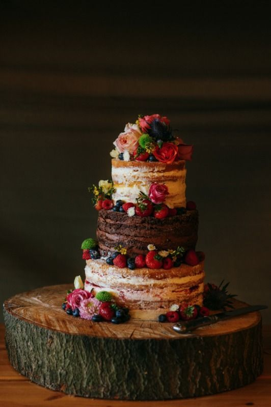 A chocolate and vanilla sponge naked cake for a festival wedding