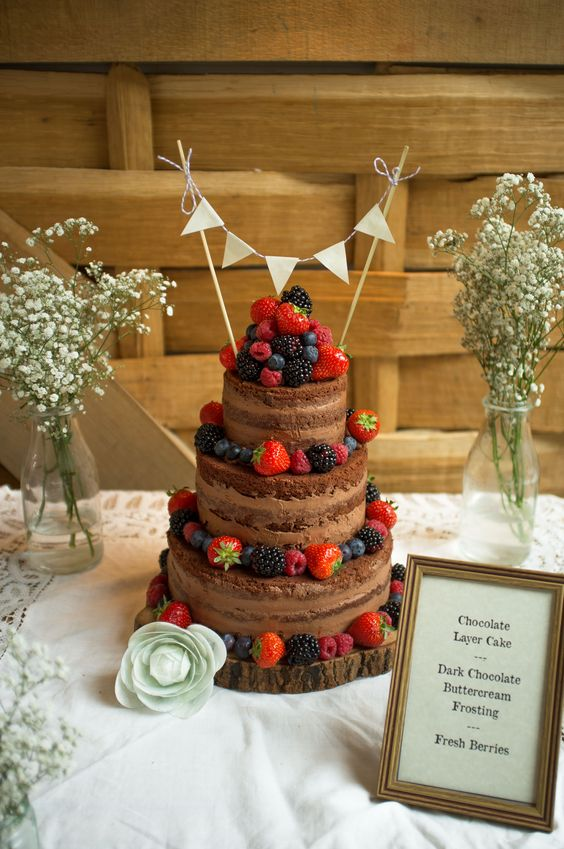 Chocolate naked wedding cake With fresh berries by oliveandanchovy