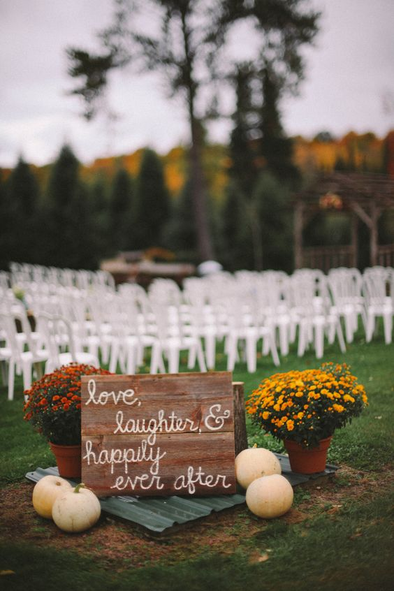 Outdoor Fall Wedding Ceremony love the sign and the ghost pumpkins