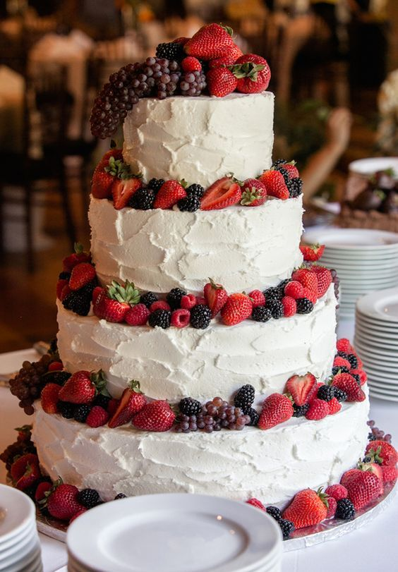 rustic buttercream wedding cake with berries